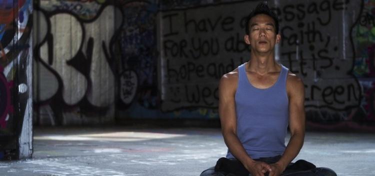 MeditatingManGraffitiBackground-850x400